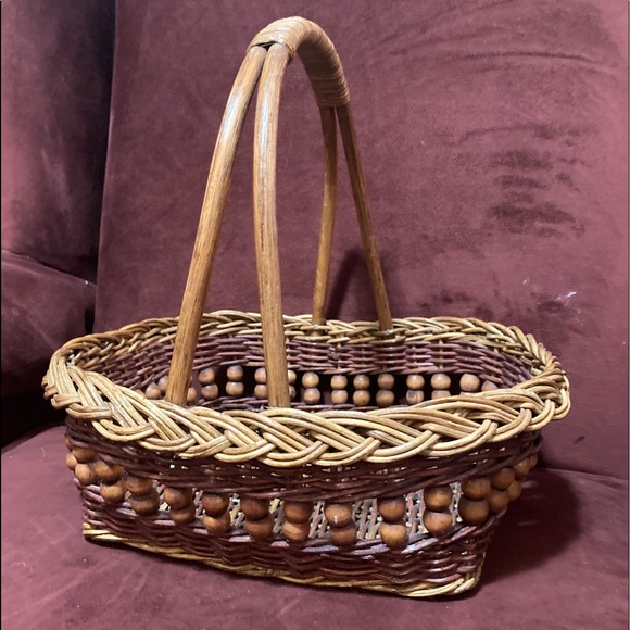 Vintage wicker basket with wooden bead detail